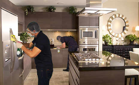 image of kitchen interiors being cleaned by professional cleaners