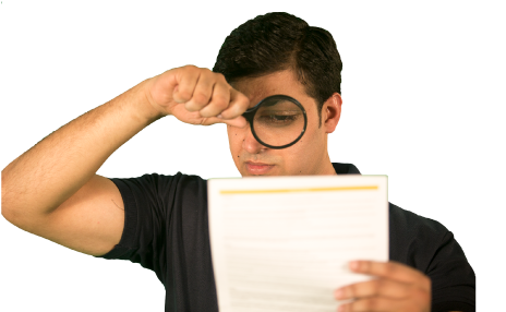 a cleaner looking at a page of print using a magnifying glass