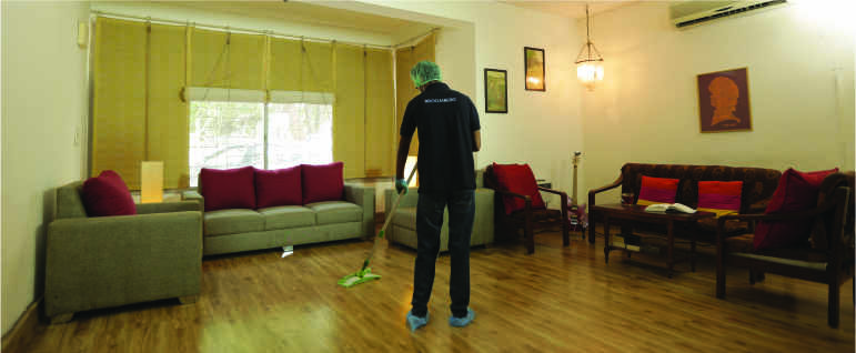 A cleaner mopping a living room